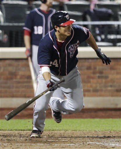 Washington Nationals' Kurt Suzuki runs to first base after hitting an RBI single during the ninth inning of a baseball game against the New York Mets Tuesday, Sept. 11, 2012, in New York. (AP Photo/Frank Franklin II)
