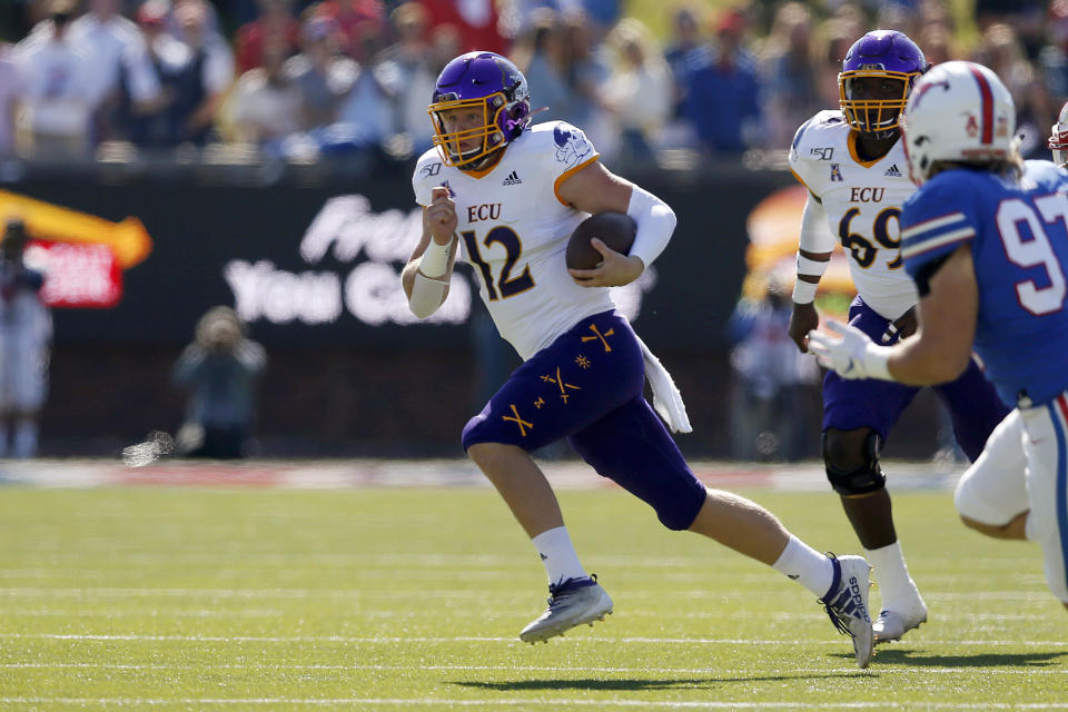 East Carolina quarterback Holton Ahlers (12) scrambles with the ball during the first half of an NCAA college football game against SMU, Saturday, Nov. 9, 2019, in Dallas. (AP Photo/Roger Steinman)