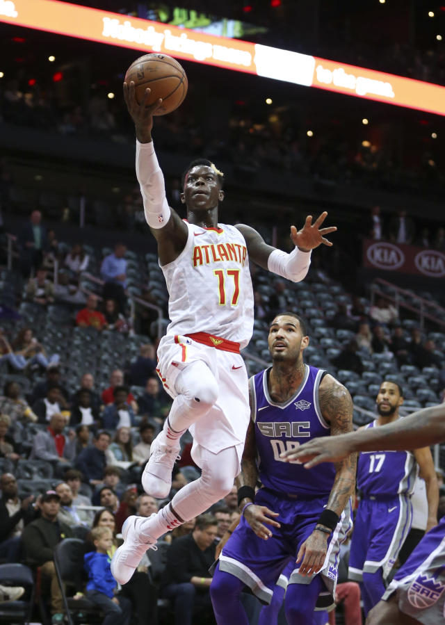 Atlanta Hawks guard Dennis Schroder (17) drives to the basket against Sacramento Kings center Willie Cauley-Stein (00) during the first half of an NBA basketball game Wednesday, Nov. 15, 2017, in Atlanta. (AP Photo/John Bazemore)