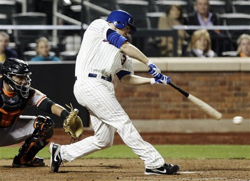 New York Mets' Josh Thole hits an RBI single during the ninth inning against the San Francisco Giants of a baseball game Friday, April 20, 2012, in New York. (AP Photo/Frank Franklin II)