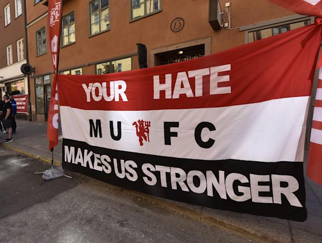 <p>A banner by Manchester United fans for the victims of the Manchester terror attack on May 22, reads: 'your hate makes us stronger' in the streets of Stockholm, Sweden, prior the Europa League final against Ajax Amsterdam on Wednesday, May 24, 2017. (AP Photo/Martin Meissner) </p>