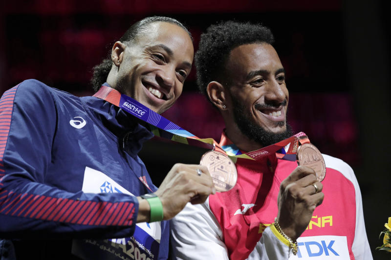 Joint bronze medalists Orlando Ortega, of Spain, right, and Pascal Martinot-Lagarde, of France, during the award ceremony for the men's 110 meter hurdles at the World Athletics Championships in Doha, Qatar, Thursday, Oct. 3, 2019. (AP Photo/Nariman El-Mofty)