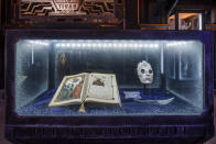 <p><em>The Book of Yggdrasil</em> (featuring Malekith's quest for the Aehter), mask, and blade were all introduced in <em>Thor: The Dark World</em>. In the first <em>Guardians</em>, a Dark Elf was one of the notable specimens in the Collector's collection. (Photo: Disneyland Resort) </p>