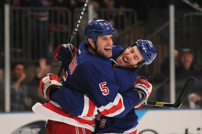 NEW YORK, NY - APRIL 26:  Dan Girardi #5 and Brandon Prust #8 of the New York Rangers celebrate Girardi's second period goal against the Ottawa Senators in Game Seven of the Eastern Conference Quarterfinals during the 2012 NHL Stanley Cup Playoffs at Madison Square Garden on April 26, 2012 in New York City.  (Photo by Bruce Bennett/Getty Images)