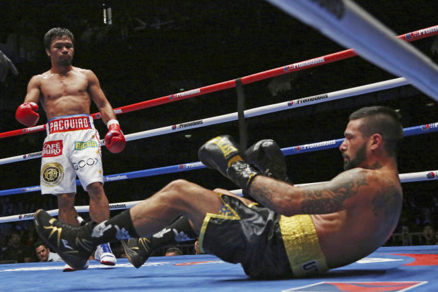 Manny Pacquiao clinched his 60th victory on July 15, 2018, with a seventh-round KO of Lucas Matthysse, his first stoppage in nine years. (AP Photo/Yam G-Jun, File)