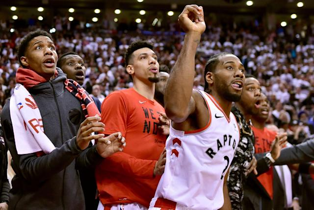 Kawhi Leonard and his teammates watch as the ball bounces around the rim before falling through as time expires Sunday in Game 7. (AP)