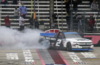 NASCAR Texas Trucks Series driver Sheldon Creed (2) celebrates with a burnout after winning an auto race at Texas Motor Speedway in Fort Worth, Texas, Sunday, Oct. 25, 2020. (AP Photo/Richard W. Rodriguez)