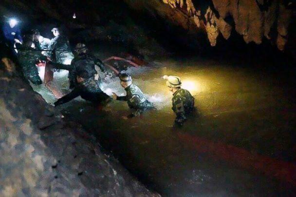 PHOTO: Rescue teams walk inside cave complex where 12 boys and their soccer coach went missing, in Mae Sai, Chiang Rai province, in northern Thailand, July 2, 2018. (Tham Luang Rescue Operation Center via AP)