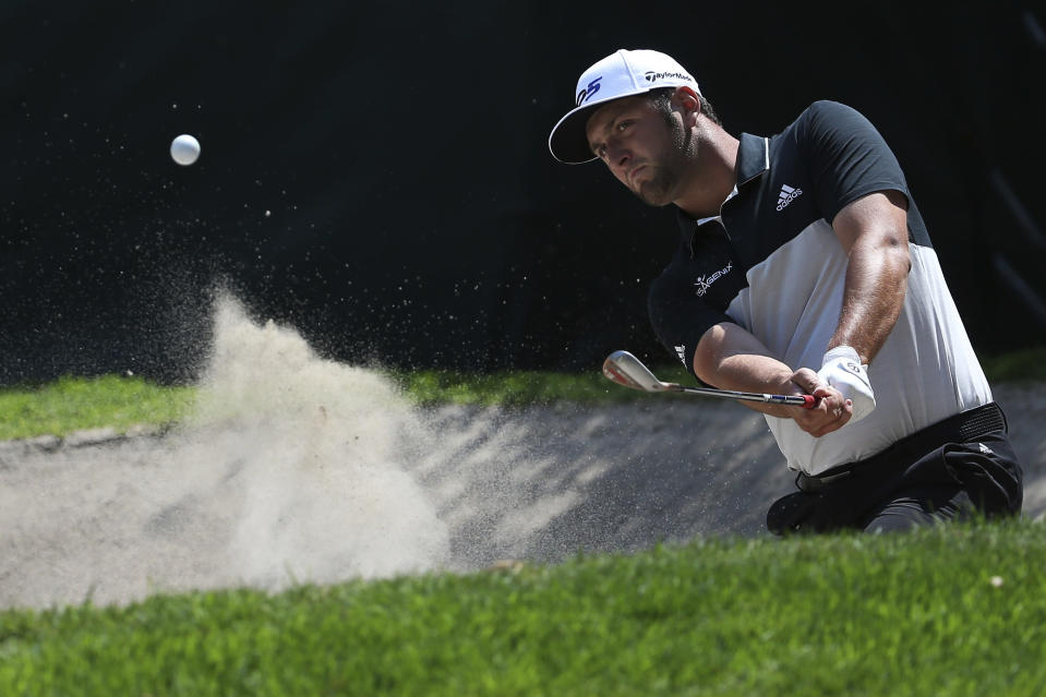 Sapin's Jon Rahm hits it out of a sand trap on the 16th hole during the first round of the Mexico Championship at the Chapultepec Golf Club in Mexico City, Thursday, March 1, 2018. (AP Photo/Marco Ugarte)