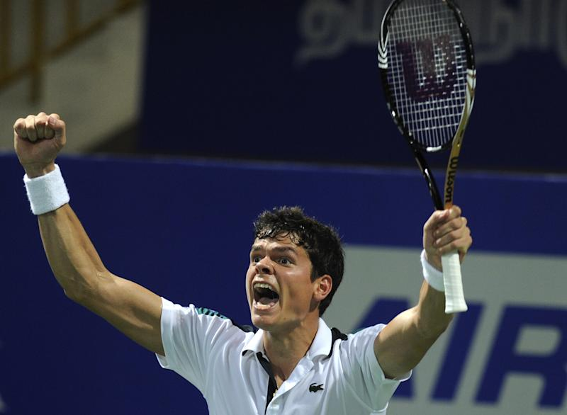 Canada's Milos Raonic celebrates his win in the final match against Serbia's Janko Tipsarevic at the ATP Chennai Open 2012 tennis tournament in Chennai, India, Sunday, Jan. 8, 2012.  Raonic won 6-7. 7-6, 7-6. (AP Photo)