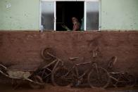 FILE PHOTO: A man works on the cleaning of a house flooded with mud after a dam, owned by Vale SA and BHP Billiton Ltd burst, in Barra Longa