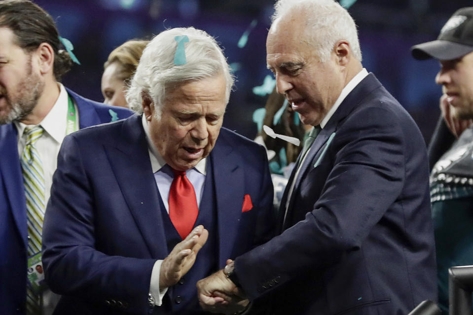 Patriots owner Robert Kraft (L) congratulates Eagles owner Jeffrey Lurie, after the Eagles won Super Bowl LII. The pair were critical of President Donald Trump during an October meeting between NFL owners and players. (AP)