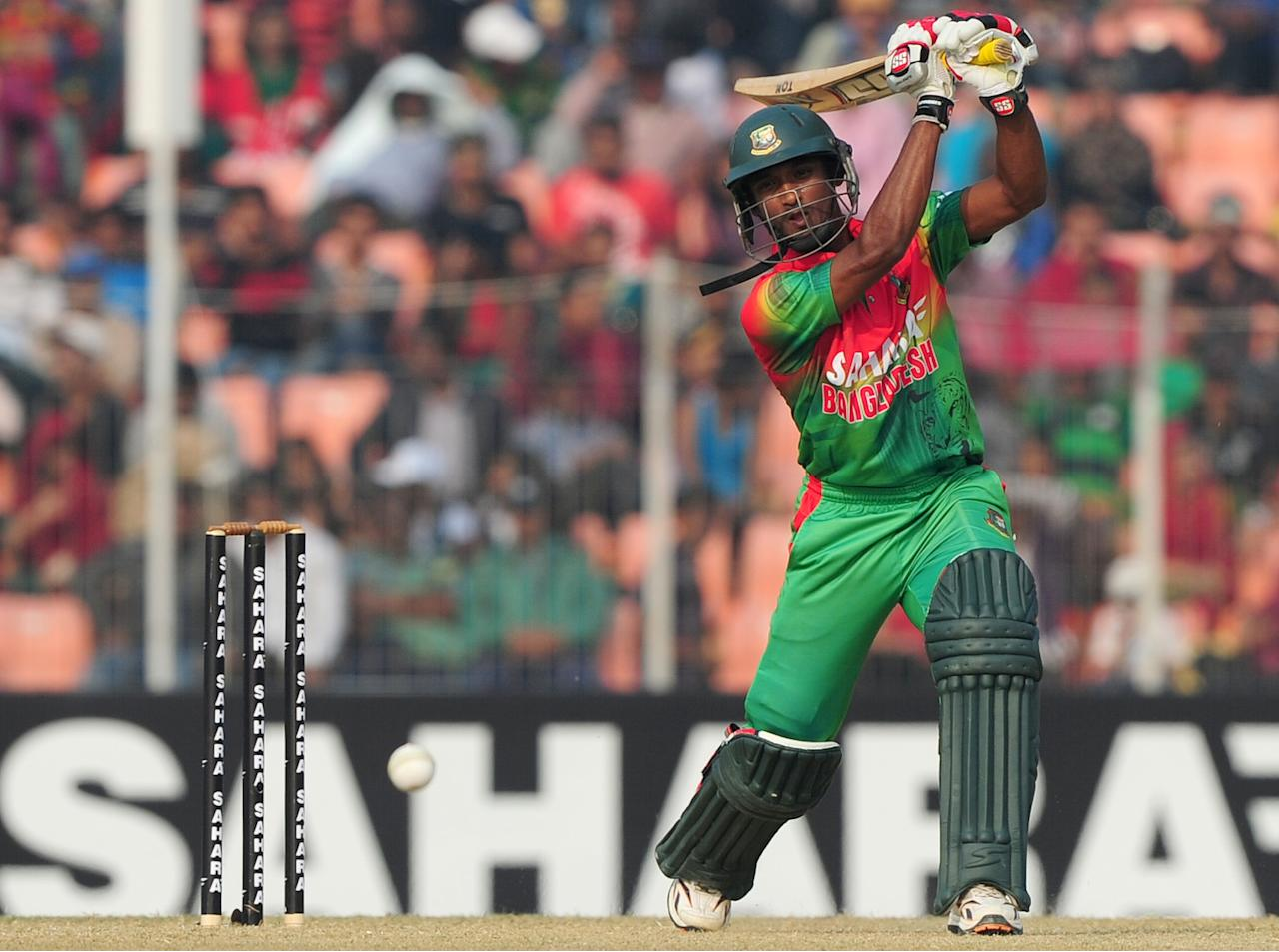 Bangladesh cricketer Naeem Islam plays a shot during the first one day international cricket match between Bangladesh and The West Indies at The Sheikh Abu Naser Stadium in Khulna on November 30, 2012. AFP PHOTO/ Munir uz ZAMAN