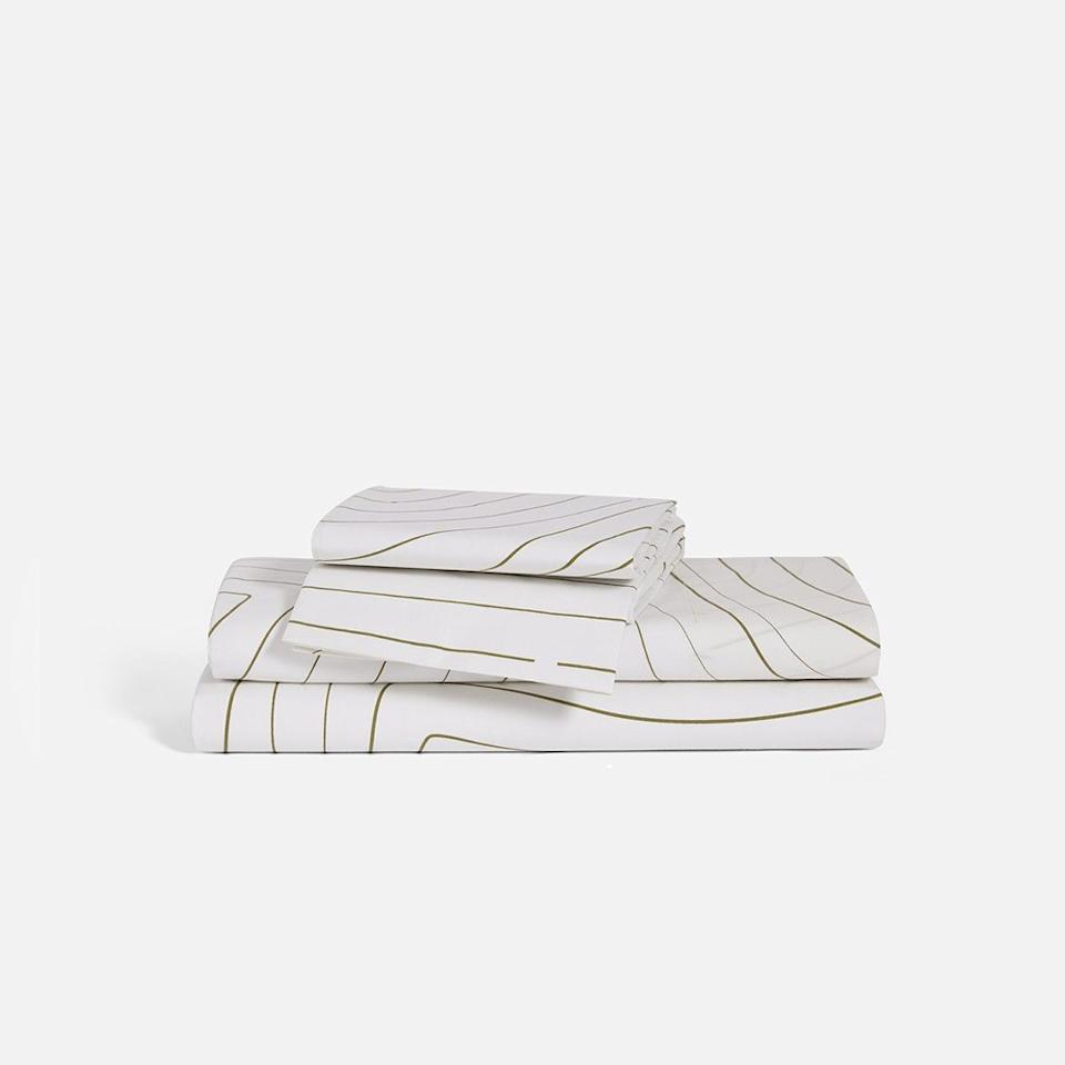 """<p>If you're not so much a percale cotton person and want some sheets with a sateen finish, this expensive-feeling sheet set is one of the best investments I've made lately—available in funky styles like this or muted block colors.</p> <p><strong>Buy it:</strong> $149, <a href=""""https://www.brooklinen.com/products/luxe-core-sheet-set?variant=17667853451354"""" rel=""""nofollow"""">brooklinen.com</a></p>"""