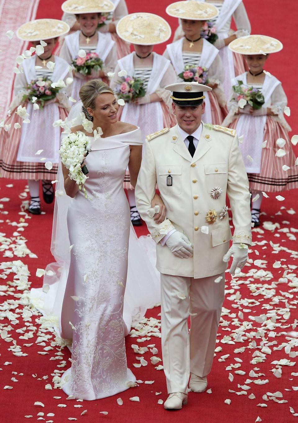 <p>Although this was not the biggest royal wedding of 2011 (you know what's coming next), Charlene Wittstock's Giorgio Armani gown is far too glamorous to be skimmed over. 2,500 hours and 80 meters of silk organza <span>reportedly</span> went into creating the former South African Olympic swimmer bride's iridescent off-white gown. </p>