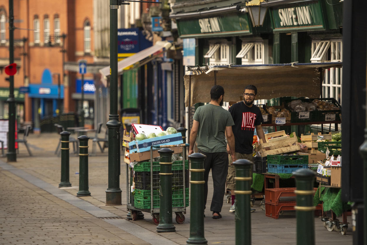 OLDHAM, ENGLAND - AUGUST 13: Shopkeepers prepare to open a grocery shop in Oldham town centre on August 13, 2020 in Oldham, England. The town is on the brink of a local lockdown after a surge in coronavirus cases has left it the worst affected area in England. (Photo by Anthony Devlin/Getty Images)