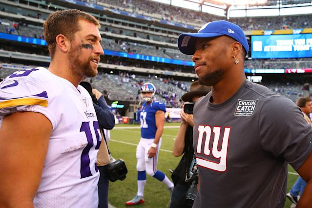 New York Giants running back Saquon Barkley (26) and Minnesota Vikings wide receiver Adam Thielen (19) after a Week 5 game. (Getty Images)