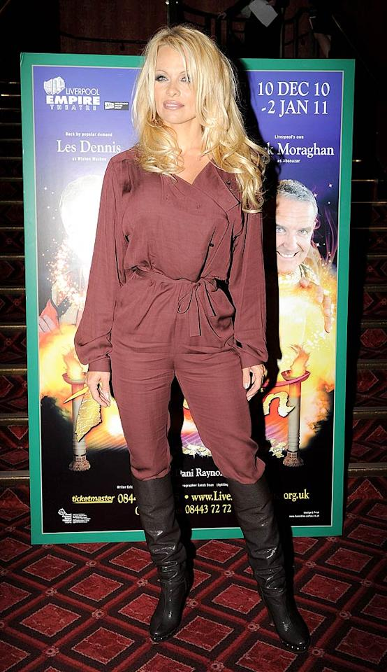 "For 43, Pam Anderson is smoking hot, but the former ""Baywatch"" babe's ""Star Trek""-meets-""Indiana Jones"" jumpsuit -- which she wore to a photo op at the Liverpool Empire Theater to promote her upcoming Christmas spectacular -- is not, especially stuffed into those shiny boots. <a href=""http://www.splashnewsonline.com"" target=""new"">Splash News</a> - August 19, 2010"