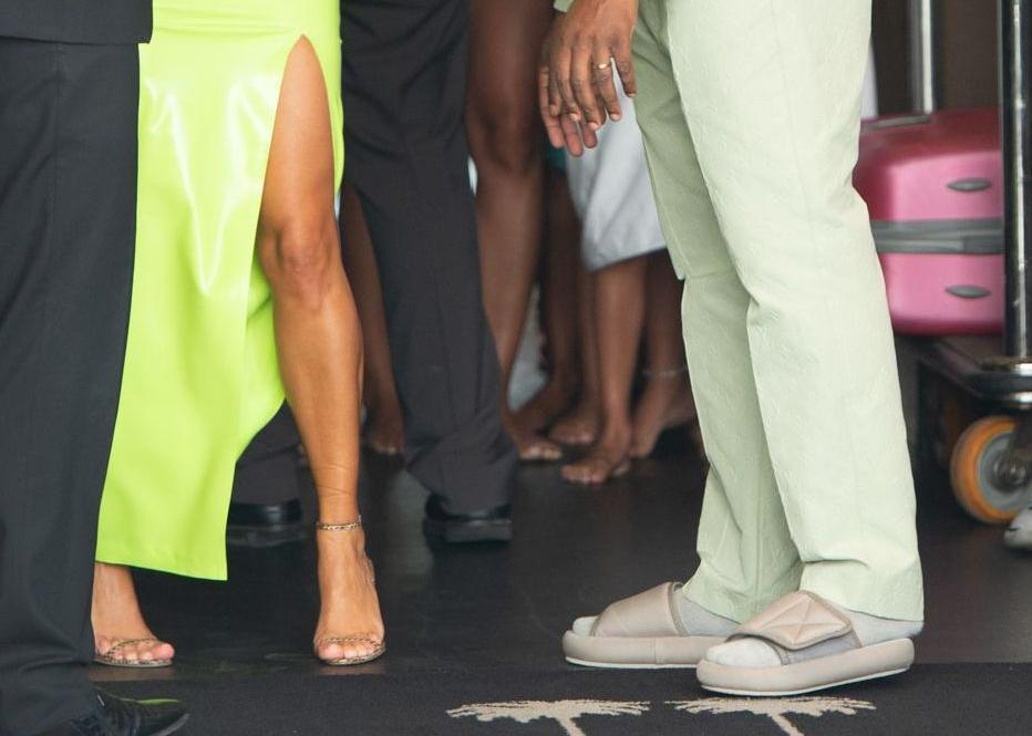 A close-up of West's small Yeezy slides at 2 Chainz's wedding to Kesha Ward. (Photo: South Beach Photo/REX/Shutterstock)