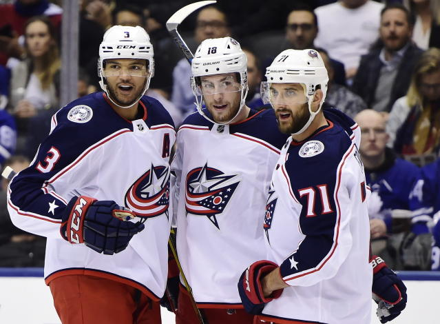 Columbus Blue Jackets left wing Pierre-Luc Dubois, center, celebrates his goal against the Toronto Maple Leafs with teammates Seth Jones, left, and Nick Foligno during first-period NHL hockey game action in Toronto, Monday, Oct. 21, 2019. (Frank Gunn/The Canadian Press via AP)