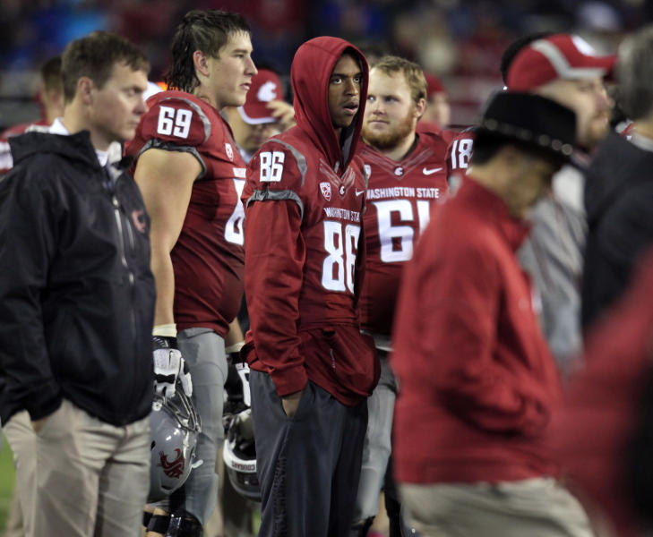 FILE - This Oct. 13, 2012 file photo shows Washington State wide receiver Marquess Wilson (86) standing on the sidelines during the fourth quarter of an NCAA college football game against California, at Martin Stadium in Pullman, Wash. Wilson was injured in the second quarter. Washington State has suspended star receiver Wilson for an unspecified violation of team rules. Team spokesman Bill Stevens could not say Monday, Nov. 5, 2012 how long the suspension would last or specifics about why Wilson was punished by first-year coach Mike Leach.(AP Photo/Dean Hare)