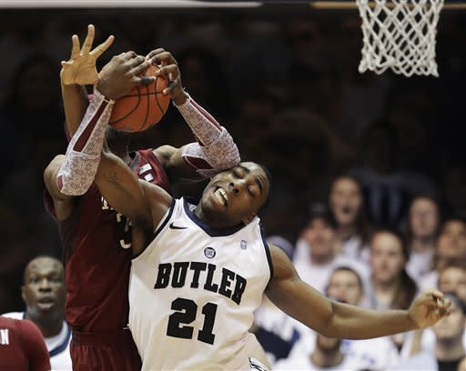 Butler's Roosevelt Jones (21) and Temple's Anthony Lee (3) battle for a rebound during the second half of an NCAA college basketball game on Saturday, Jan. 26, 2013, in Indianapolis. Butler defeated Temple 83-71. (AP Photo/Darron Cummings)
