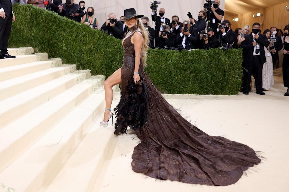 Jennifer Lopez wears a brown Ralph Lauren dress at The 2021 Met Gala Celebrating In America: A Lexicon Of Fashion at Metropolitan Museum of Art on September 13, 2021 in New York City.
