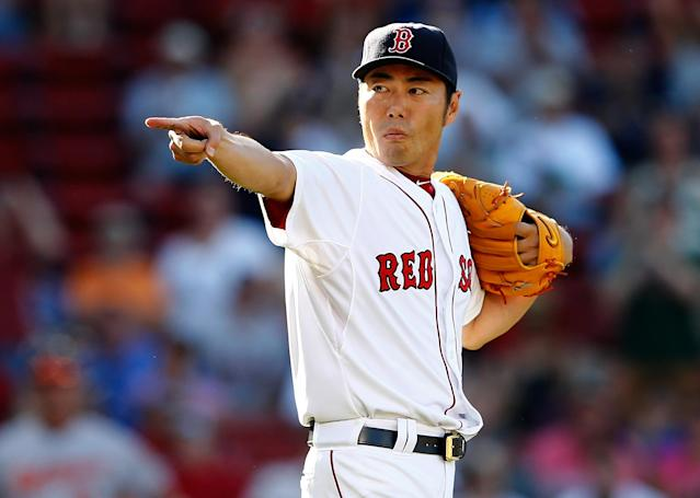 BOSTON, MA - JULY 6: Koji Uehara #19 of the Boston Red Sox reacts after picking off a base runner in the 10th inning against the Baltimore Orioles at Fenway Park on July 6, 2014 in Boston, Massachusetts. (Photo by Jim Rogash/Getty Images)