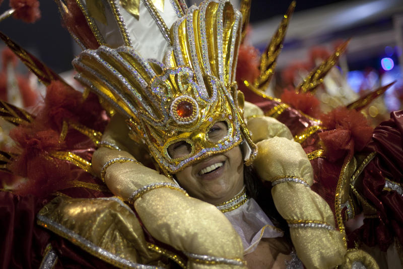 A dancer from the Dragoes da Real samba school performs during a carnival parade in Sao Paulo, Brazil, early Saturday, Feb. 9, 2013. (AP Photo/Andre Penner)