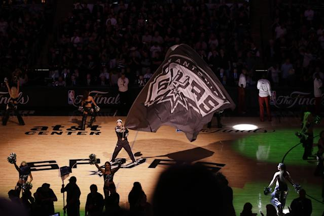The San Antonio Spurs and Miami Heat are introduced before Game 1 of the NBA basketball finals on Thursday, June 5, 2014, in San Antonio. (AP Photo/Tony Gutierrez)