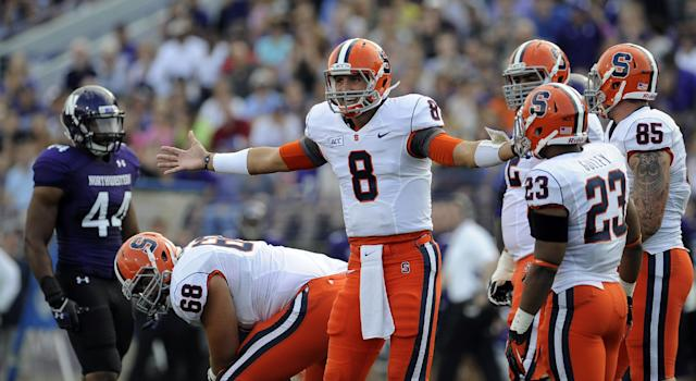 Syracuse's Drew Allen (8) signals to his coaches during the first half of an NCAA college football game Saturday, Sept. 7, 2013 in Evanston, Ill. (AP Photo/Matt Marton)