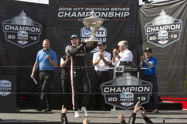 FILE - In this Sunday, Sept. 22, 2019, file photo, Josef Newgarden raises the trophy in the air after winning the championship after an IndyCar auto race at Laguna Seca Raceway in Monterey, Calif. The IndyCar season begins with the Grand Prix of St. Petersburg in St. Petersburg, Fla., on Sunday, March 15, 2020. (AP Photo/David Royal, File)