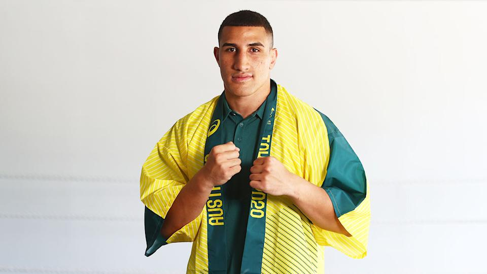 Justis Huni is pictured here wearing the Australian Olympic Games colours.