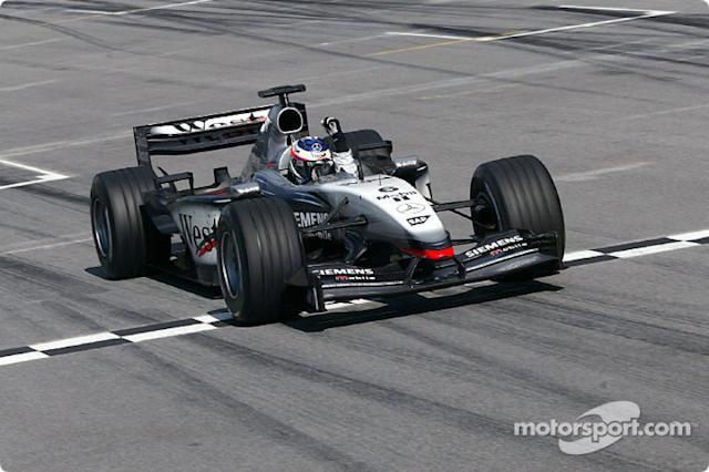 "Kimi Raikkonen takes the checkered flag <span class=""copyright"">DaimlerChrysler</span>"