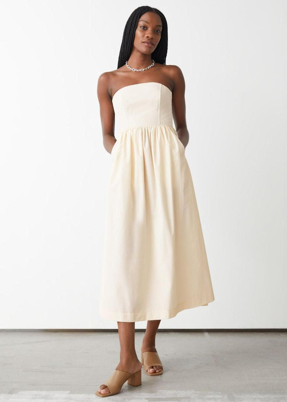 <p>This <span>&amp; Other Stories Voluminous Bandeau Midi Dress</span> ($129) will make a statement in the most understated way. It looks crisp, modern and polished.</p>