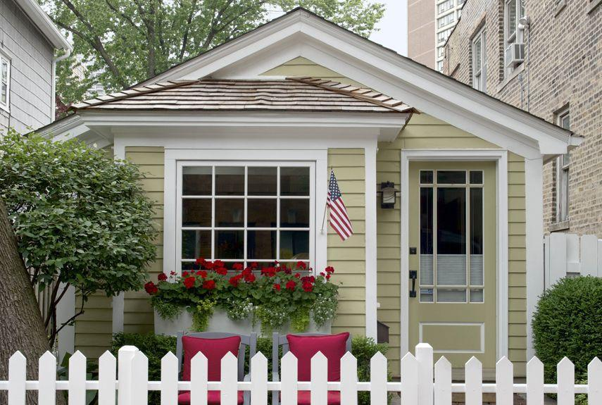 """<p>It's hard to believe this cute-as-a-button 780-square-foot historic cottage sits in the middle of a bustling metropolis. The house, owned by David Hawkanson, the executive director of Chicago's <a href=""""https://www.steppenwolf.org/"""" rel=""""nofollow noopener"""" target=""""_blank"""" data-ylk=""""slk:Steppenwolf Theater Company"""" class=""""link rapid-noclick-resp"""">Steppenwolf Theater Company</a>, was built a few years after the Great Chicago Fire of 1871, when the Chicago Relief and Aid Society began offering so-called fire-relief cottage kits that included pre-cut wood, a door, a chimney, and a room partition. While historians believe more of these tiny cottages exist in Chicago, all but a couple of examples (like Hawkanson's) have become unrecognizable thanks to extensive renovations over the years.</p><p><a class=""""link rapid-noclick-resp"""" href=""""https://www.countryliving.com/home-design/house-tours/a5782/tiny-chicago-cottage-new-york-times/"""" rel=""""nofollow noopener"""" target=""""_blank"""" data-ylk=""""slk:SEE INSIDE"""">SEE INSIDE</a></p>"""