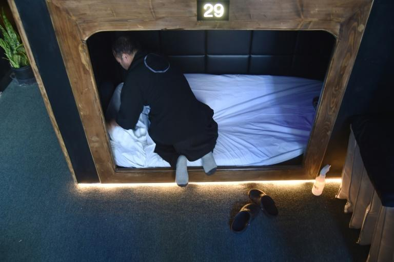 A worker prepares a sleep cabin for a new client at Nap York, in New York