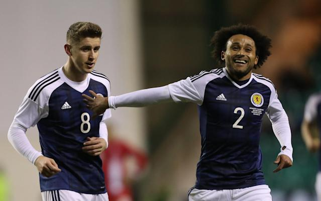 <span>Ikechi Anya (right) celebrates Scotland's equaliser against Canada with debutant teammate Tom Cairney</span> <span>Credit: Ian MacNicol/Getty </span>