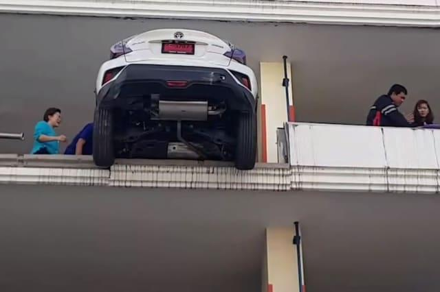 World's worst parking! Driver hits reverse and smashes through 50ft high concrete wall