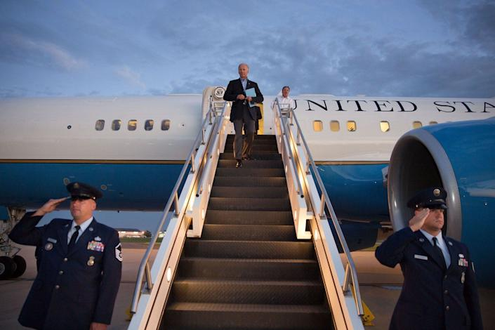 Vice President Joe Biden walks down the stairs of Air Force Two at New Castle County Airport. Wilmington, Delaware, Aug. 23,2013.