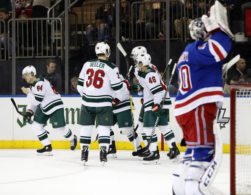 Minnesota Wild right wing Mikael Granlund (64) skates towards the bench after he scored a goal against New York Rangers goaltender Alexandar Georgiev (90), of Bulgaria, during the first period of an NHL hockey game in New York, Friday, Feb. 23, 2018. (AP Photo/Kathy Willens)