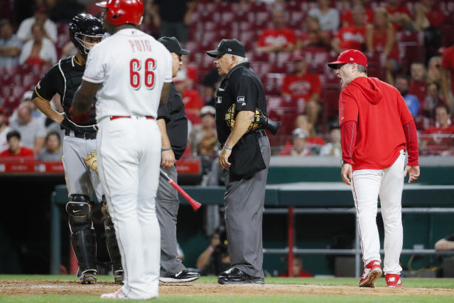 Cincinnati Reds manager David Bell, right, yells at umpire Larry Vanover, center, after being ejected during the ninth inning of a baseball game against the Pittsburgh Pirates, Tuesday, July 30, 2019, in Cincinnati. (AP Photo/John Minchillo)