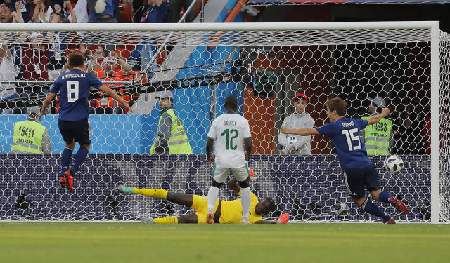 Senegal goalkeeper Khadim Ndiaye is beaten by the equalizing goal of Japan's Takashi Inui (not in the picture)during the group H match between Japan and Senegal at the 2018 soccer World Cup at the Yekaterinburg Arena in Yekaterinburg , Russia, Sunday, June 24, 2018. (AP Photo/Vadim Ghirda)