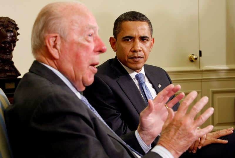 FILE PHOTO: U.S. President Barack Obama listens as former U.S. Secretary of State George Shultz speaks in the Oval Office of the White House in Washington
