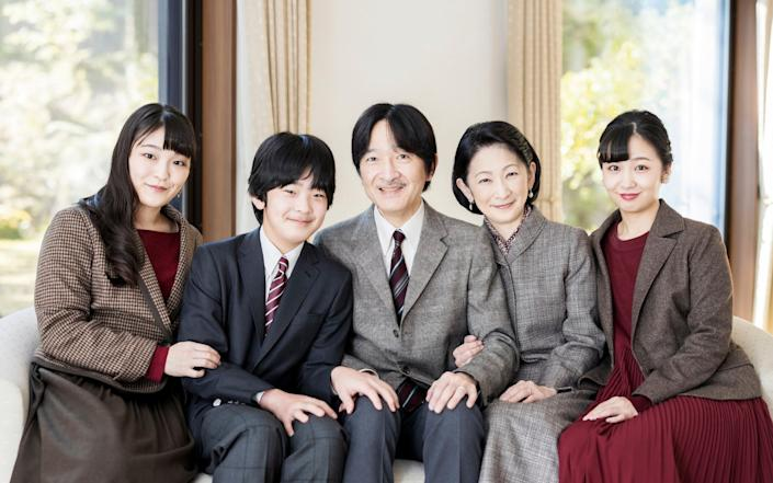 Japan's Crown Prince Akishino, cente, with his wife Crown Princess Kiko, second right, and their children, Princess Mako, left, Princess Kako and Prince Hisahito in November 2020 - Imperial Household Agency of Japan via AP