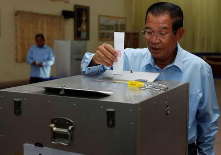 Cambodia's Prime Minister and President of the Cambodian People's Party (CPP), Hun Sen drops a ballot into a box during a senate election in Takhmao, Kandal province, Cambodia February 25, 2018. REUTERS/Samrang Pring