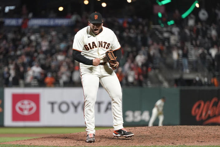 San Francisco Giants pitcher Kervin Castro celebrates after the Giants defeated the San Diego Padres in a baseball game to clinch a postseason berth in San Francisco, Monday, Sept. 13, 2021. (AP Photo/Jeff Chiu)