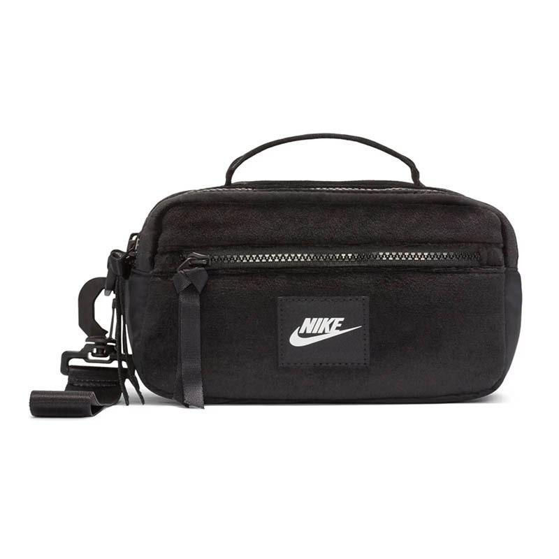 "Nobody is really wearing handbags these days, so gift the trendsetter in your circle this adorable pouch she can strap across her chest. It's the hands-free solution to keeping her essentials out of her pockets and in one spot. $35, Nordstrom. <a href=""https://www.nordstrom.com/s/nike-sportswear-winterized-utility-bag/5619704"" rel=""nofollow noopener"" target=""_blank"" data-ylk=""slk:Get it now!"" class=""link rapid-noclick-resp"">Get it now!</a>"