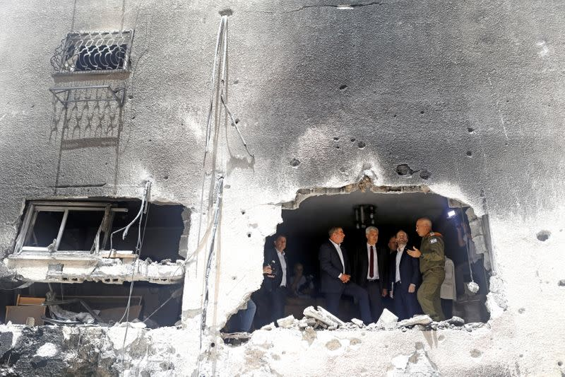 FILE PHOTO: Israeli Foreign Minister Ashkenazi speaks to his Czech counterpart Kulhanek and Slovak counterpart Korcok as they visit the site of a building damaged by a rocket launched from the Gaza Strip last week, in Petah Tikva