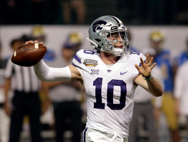 FILE - In this Dec. 26, 2017, file photo, Kansas State quarterback Skylar Thompson (10) throws down field against UCLA in the first half of the NCAA college football Cactus Bowl game, in Phoenix. Kansas State returns 14 starters from a team that won eight games and beat UCLA in the Cactus Bowl, including its top quarterback and the entire offensive line, so it stands to reason that few jobs would be available in spring camp. Thats hardly the case. Especially at quarterback. (AP Photo/Rick Scuteri, File)